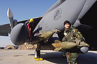"""- laser guided bombs are loaded on a F 15E """"Strike Eagle""""  fighter-bomber in the US air base  of Aviano (Pordenone, Italy)<br /> <br /> - bombe a guida laser vengono caricate su un cacciabombardiere F 15E """"Strike Eagle""""  nella base USA di Aviano (Pordenone)"""