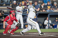 Michigan Wolverines second baseman Jimmy Kerr (15) follows through on his swing against the Indiana Hoosiers during the NCAA baseball game on April 21, 2017 at Ray Fisher Stadium in Ann Arbor, Michigan. Indiana defeated Michigan 1-0. (Andrew Woolley/Four Seam Images)
