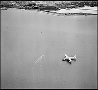 BNPS.co.uk (01202 558833)<br /> Pic: Aerofilms/HistoricEngland/BNPS<br /> <br /> Poole Harbour, 3 October 1946. - The harbour was the hub for inter-continental air travel by flying boat in the post war years.<br /> <br /> Stunning historic aerial photos of seaside towns, naval bases, ports and shipyards which tell the story of Britain's once-great maritime tradition feature in a new book.<br /> <br /> The fascinating archive of black and white images includes views from a bygone age such as Brighton's famous West Pier, Grimsby's burgeoning fishing fleet, and London's dock yards.<br /> <br /> Iconic ships were also captured from the skies including the Cutty Sark in its final seaworthy years on the Thames, HMY Britannia in 1959, the RMS Queen Mary in 1946 and the SS Queen Elizabeth in 1969 about to make her maiden voyage.<br /> <br /> England's Maritime Heritage from the Air, by Peter Waller, is published by English Heritage and costs &pound;35.