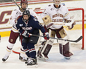 Steve Santini (BC - 6), Jacob Poe (UConn - 5), Thatcher Demko (BC - 30) - The Boston College Eagles defeated the visiting University of Connecticut Huskies 3-2 on Saturday, January 24, 2015, at Kelley Rink in Conte Forum in Chestnut Hill, Massachusetts.