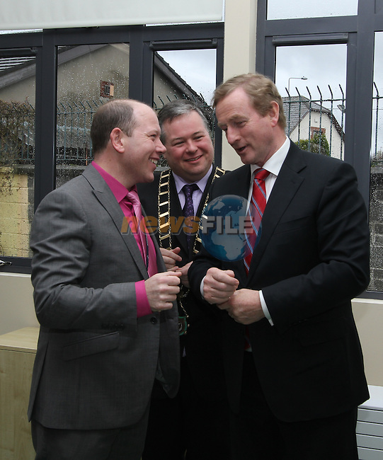 Taoiseach Enda Kenny with Mayor Paul Bell and Principal Micheál Moley as he visits St.Endas School in Drogheda to celebrate 50 Years Open and to Open the New Building...(Photo credit should read Jenny Matthews/NEWSFILE)...