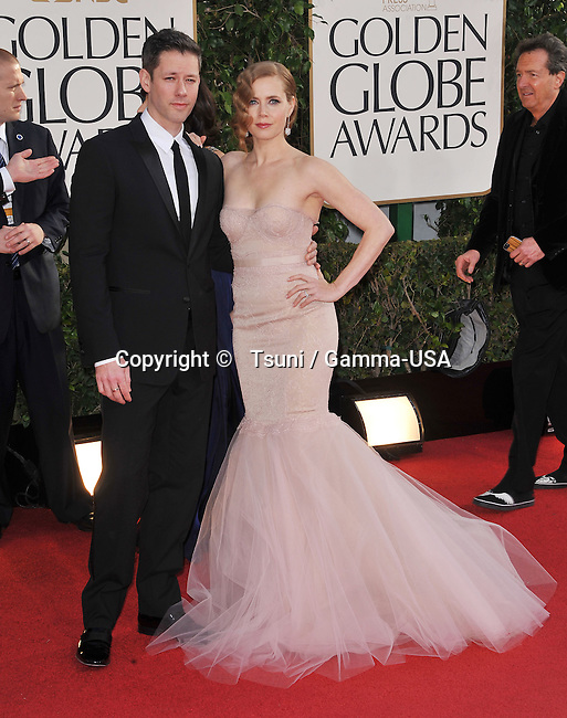 Amy Adams and Darren Le Gallo  at the 70th Golden Globes Awards 2013 at the  Hilton Hotel In Beverly Hills.