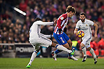 Antoine Griezmann of Atletico de Madrid battles for the ball with Raphael Varane of Real Madrid during their La Liga match between Atletico de Madrid and Real Madrid at the Vicente Calderón Stadium on 19 November 2016 in Madrid, Spain. Photo by Diego Gonzalez Souto / Power Sport Images
