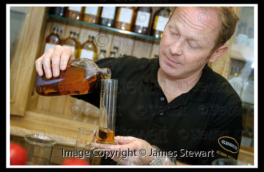 22/09/2006       Copyright Pic: James Stewart.File Name :sct_jspa05_glengoyne.ROBBIE HUGHES, DISTILLERY MANAGER, GLENGOYNE DISTILLERY, DUMGOYNE, IN THE BLENDING ROOM....Payments to :.James Stewart Photo Agency 19 Carronlea Drive, Falkirk. FK2 8DN      Vat Reg No. 607 6932 25.Office     : +44 (0)1324 570906     .Mobile   : +44 (0)7721 416997.Fax         : +44 (0)1324 570906.E-mail  :  jim@jspa.co.uk.If you require further information then contact Jim Stewart on any of the numbers above.........