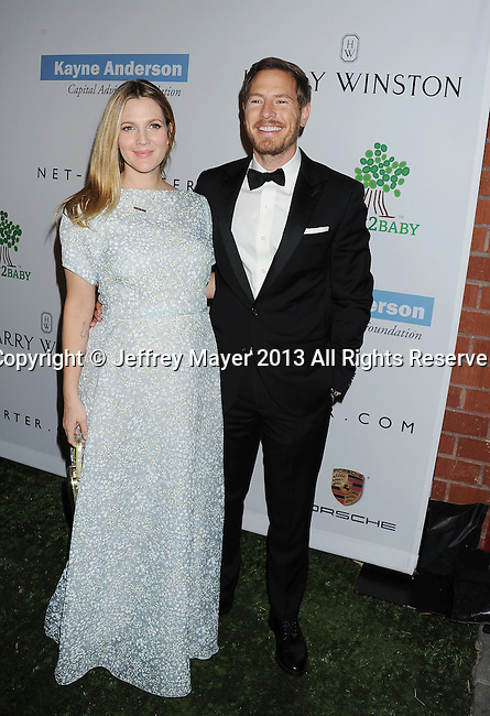 CULVER CITY, CA- NOVEMBER 09: Actress Drew Barrymore (L) and husband/actor Will Kopelman arrive at the 2nd Annual Baby2Baby Gala at The Book Bindery on November 9, 2013 in Culver City, California.