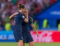 PARIS,  - JUNE 28: Charlotte Bilbault #14 comforts Marion Torrent #4 during a game between France and USWNT at Parc des Princes on June 28, 2019 in Paris, France.