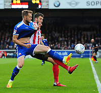 Lincoln City's Ollie Palmer vies for possession with Chesterfield's Scott Wiseman<br /> <br /> Photographer Chris Vaughan/CameraSport<br /> <br /> The EFL Sky Bet League Two - Lincoln City v Chesterfield - Saturday 7th October 2017 - Sincil Bank - Lincoln<br /> <br /> World Copyright &copy; 2017 CameraSport. All rights reserved. 43 Linden Ave. Countesthorpe. Leicester. England. LE8 5PG - Tel: +44 (0) 116 277 4147 - admin@camerasport.com - www.camerasport.com