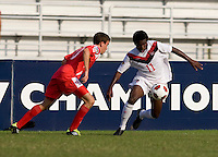 Christopher Nanco (11) of Canada tries to get past Francisco Narbon (13) of Panama during the semifinals of the CONCACAF Men's Under 17 Championship at Catherine Hall Stadium in Montego Bay, Jamaica. Canada defeated Panama, 1-0.