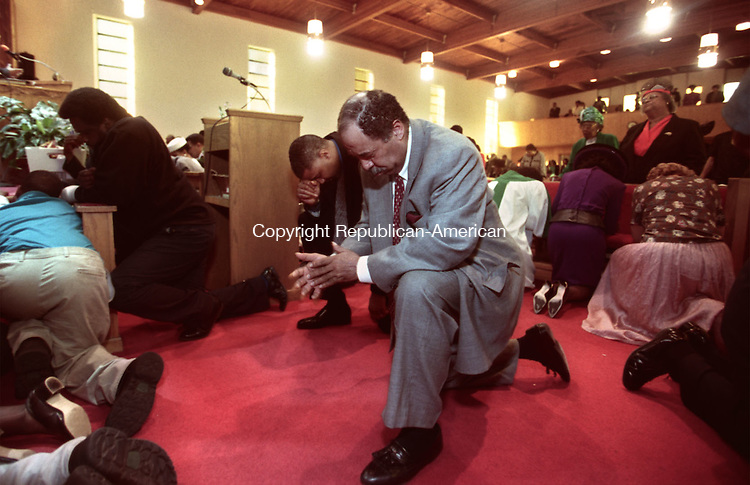 WATERBURY, CT 11/22/98 --1122JH08.tif--People praying during Sunday services at the Zion Baptist Church in Waterbury. JOHN HARVEY staff photo for Adams story.