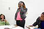 After finishing his group's outline for their Basic Writing II final project, Tony Jones, left, a student at Montgomery College in Takoma Park, Md. talks with Isatu Kanu, right, before going to lunch. If students pass this class, it allows them to progress to the college level english program. Otherwise students will face the decision to take the remedial class again or drop out.