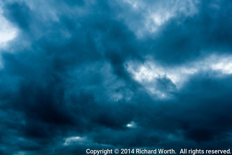 Large textured clouds with blue evening tint for background.