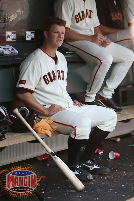 SAN FRANCISCO - SEPTEMBER 27:  Matt Cain #18 of the San Francisco Giants sits in the dugout during the game against the Chicago Cubs at AT&T Park on September 27, 2009 in San Francisco, California. Photo by Brad Mangin