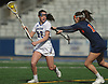 Shannon Boyle #32 of of Hofstra University, left, gets pressured by Morgan Steinhacker #12 of Bucknell during an NCAA women's lacrosse game at Shuart Stadium in Hempstead, NY on Saturday, Feb. 17, 2018. Hofstra cruised to a 13-1 win.