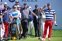 Marc Leishman (AUS) and Kevin Chappell (USA) look over their tee shots on 1 during round 4 Singles of the 2017 President's Cup, Liberty National Golf Club, Jersey City, New Jersey, USA. 10/1/2017. <br /> Picture: Golffile | Ken Murray<br /> <br /> All photo usage must carry mandatory copyright credit (&copy; Golffile | Ken Murray)
