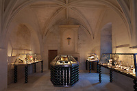 The Upper Chapel, themed as 'L'Engagement' or Commitment, with treasures housed in cabinets with bases and legs made from black glass beads by Murano glassmaker Salviati, in Le Tresor de la Cathedral d'Angouleme, in Angouleme Cathedral, or the Cathedrale Saint-Pierre d'Angouleme, Angouleme, Charente, France. The 12th century Romanesque cathedral was largely reworked by Paul Abadie in 1852-75. In 2008, Jean-Michel Othoniel was commissioned by DRAC Aquitaine - Limousin - Poitou-Charentes to display the Treasure of the Cathedral in some of its rooms, which opened to the public on 30th September 2016. Picture by Manuel Cohen. L'autorisation de reproduire cette oeuvre doit etre demandee aupres de l'ADAGP/Permission to reproduce this work of art must be obtained from DACS.