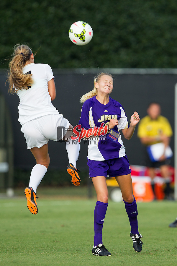 Allie Bunner (2) of the James Madison Dukes fights for a jump ball with Sarah Teegarden (7) of the Wake Forest Demon Deacons at Spry Soccer Stadium on August 29, 2014 in Winston-Salem, North Carolina.  The Dukes defeated the Demon Deacons 2-1.   (Brian Westerholt/Sports On Film)