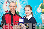 Maggie Dennehy, pictured as she received the Anne Casey Joy memorial trophy from Annes brother and teacher Declan Casey at the Scoil Phobail Sliabh Luachra, Rathmore, awards ceremony on Thursday. ..........................................................................