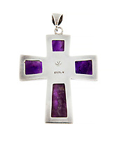 BNPS.co.uk (01202 558833)<br /> Pic: Juliens/BNPS<br /> <br /> Amethyst cross.<br /> <br /> A spectacular collection of over 1,000 items charting Elizabeth Taylor's life including her iconic outfits are up for sale for over £1million. ($1.25million)<br /> <br /> Dozens of designer gowns, fur coats and capes are being auctioned by the trustees of the estate of the late English actress.<br /> <br /> Also going under the hammer are the Hollywood icon's stylish wigs, scarves, shoes and jewellery.<br /> <br /> Items of her lavish furniture from her luxury homes across the world, right down to her personalised salt and pepper shaker, are included.