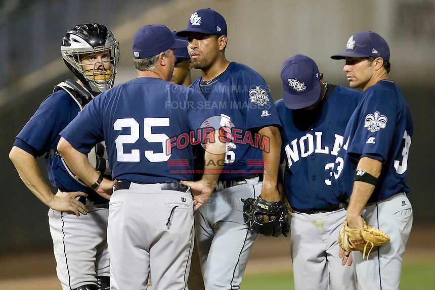New Orleans Zephyrs pitcher Cesar Valdez #26 meets with pitching coach Charlie Corbell #25 and teammates during a game against the Round Rock Express at the Dell Diamond on July 20, 2011 in Round Rock, Texas.  New Orleans defeated Round Rock 14-11.  (Andrew Woolley/Four Seam Images)