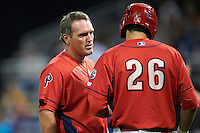 Williamsport Crosscutters manager Andy Tracy #22 talks with Chris Serritella #26 during a NY-Penn League game against the Batavia Muckdogs at Dwyer Stadium on August 24, 2012 in Batavia, New York.  Williamsport defeated Batavia 7-4.  (Mike Janes/Four Seam Images)