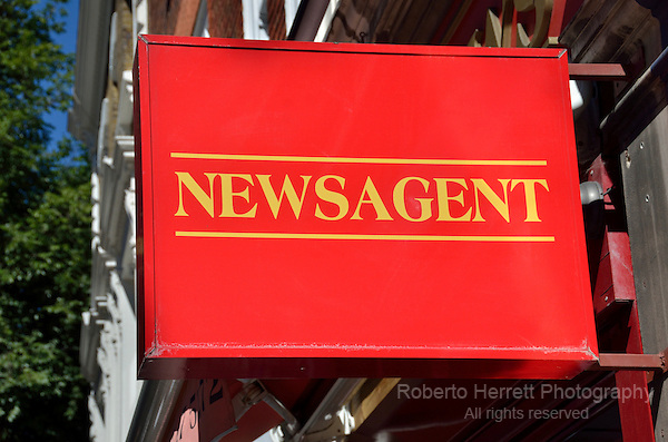 Red newsagent sign