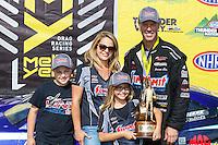 Jun 19, 2016; Bristol, TN, USA; NHRA pro stock driver Jason Line celebrates with his wife and children after winning the Thunder Valley Nationals at Bristol Dragway. Mandatory Credit: Mark J. Rebilas-USA TODAY Sports