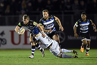 Jonathan Evans of Bath Rugby is tackled by Julian Salvi of Exeter Chiefs. West Country Challenge Cup match, between Bath Rugby and Exeter Chiefs on October 10, 2015 at the Recreation Ground in Bath, England. Photo by: Patrick Khachfe / Onside Images