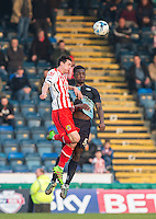 Offrande Zanzala of Stevenage & Anthony Stewart of Wycombe Wanderers go up for the ball during the Sky Bet League 2 match between Wycombe Wanderers and Stevenage at Adams Park, High Wycombe, England on 12 March 2016. Photo by Andy Rowland/PRiME Media Images.
