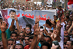 Supporters of Egypt's ousted President Mohammed Morsi, shout slogans during a protest in the Helwan district southern Cairo, Egypt, Monday, Aug. 19, 2013. Tensions in Egypt have soared since the army ousted Morsi, Hosni Mubarak's successor, in a July 3 coup following days of protests by millions of Egyptians demanding the Islamist president leave and accusing him of abusing his powers. But Morsi's supporters have fought back, staging demonstrations demanding that he be reinstated and denouncing the military coup. On Wednesday, the military raided two protest camps of Morsi's supporters in Cairo, killing hundreds of people and triggering the current wave of violence. Photo by Ahmed Asad