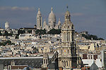 France, Paris.  <br /> It's worth finding public locations that offer views of a city, like museums, restaurants, and here Printemps. Sacre Coeur Bascillica from the Pompidou Center, Paris, France.