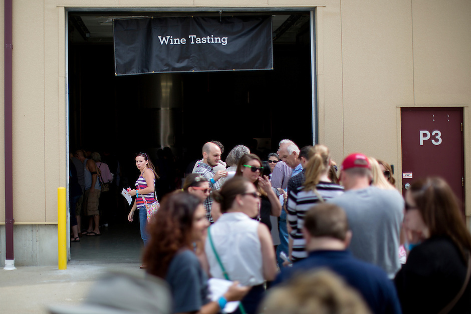 People wait in line for wine tasting during Oliver Winery's Harvest Wine Festival on Saturday, Sept.. 25, 2014. (Photo by James Brosher)