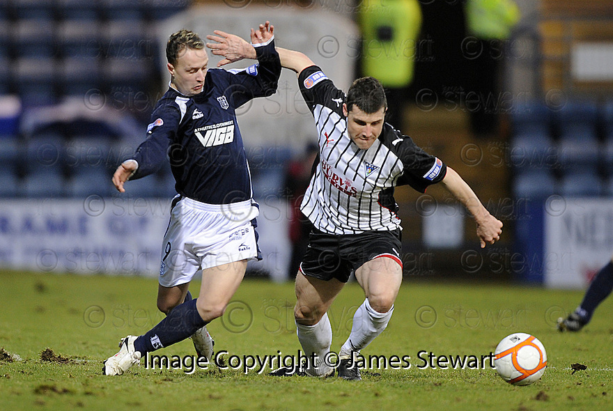17/01/2010  Copyright  Pic : James Stewart.sct_jspa_12_dundee_v_dunfermline  .:: LEIGH GRIFFITHS AND AUSTIN MCCANN CHALLENGE FOR THE BALL ::.James Stewart Photography 19 Carronlea Drive, Falkirk. FK2 8DN      Vat Reg No. 607 6932 25.Telephone      : +44 (0)1324 570291 .Mobile              : +44 (0)7721 416997.E-mail  :  jim@jspa.co.uk.If you require further information then contact Jim Stewart on any of the numbers above.........