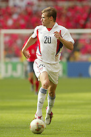 Brian McBride looks to pass the ball. The USA tied South Korea, 1-1, during the FIFA World Cup 2002 in Daegu, Korea.