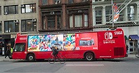 A bus advertising the Nintendo Switch outside of a Nintendo Switch event in Flatiron Plaza in New York on the launch day of the new Nintendo Switch console on Friday, March 3, 2017. (© Richard B. Levine)