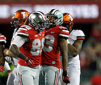 Ohio State Buckeyes linebacker Darron Lee (43) reacts with Ohio State Buckeyes defensive lineman Steve Miller (88) in the first quarter of the NCAA football game at Ohio Stadium on Saturday, November 1, 2014. (Columbus Dispatch photo by Jonathan Quilter)