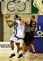 Saints imports Damon Thronton and Mike Efevberha keep the ball from Cougars import Trenton Wurtz during the NBL match between the Wellington Saints and Christchurch Cougars at Te Rauparaha Stadium, Porirua, Wellington, New Zealand on Saturday 4 April 2009. Photo: Dave Lintott / lintottphoto.co.nz
