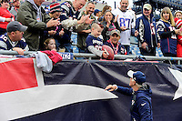 Sunday, October 2, 2016: New England Patriots offensive line coach Dante Scarnecchia gives a young fan a football at the NFL game between the Buffalo Bills and the New England Patriots held at Gillette Stadium in Foxborough Massachusetts. Buffalo defeats New England 16-0. Eric Canha/Cal Sport Media