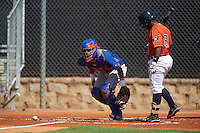 GCL Mets catcher Juan Uriarte (17) checks the runner after blocking a pitch as Randy Vasquez (61) bats during the first game of a doubleheader against the GCL Astros on August 5, 2016 at Osceola County Stadium Complex in Kissimmee, Florida.  GCL Astros defeated the GCL Mets 4-1 in the continuation of a game started on July 21st and postponed due to inclement weather.  (Mike Janes/Four Seam Images)