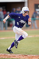 Chris Clare (9) of the High Point Panthers hustles down the first base line against the UNCG Spartans at Willard Stadium on February 14, 2015 in High Point, North Carolina.  The Panthers defeated the Spartans 12-2.  (Brian Westerholt/Four Seam Images)