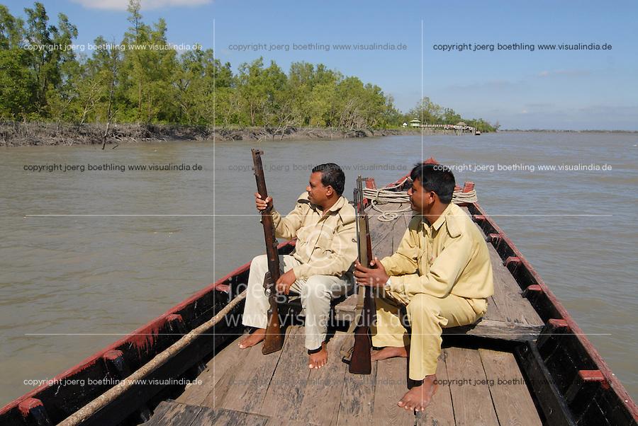 Bangladesh , Khulna, armed ranger with patrol boat in protected Mangrove forest in Sundarbans, the Ganges river delta / Bangladesch , Bewaffnete Ranger im Nationalpark Sunderbans , geschuetzter Mangrovenwald im Gangesdelta