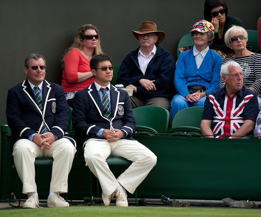 Line judges take a seat during a change over in the match between Richard Gasquet (FRA) and Marcel Granollers (ESP) in their Gentlemen's Singles First Round match today - Richard Gasquet (FRA) [9] def Marcel Granollers (ESP) 6-7(2) 6-4 7-5 6-4 <br /> <br />  (Photo by Stephen White/CameraSport) <br /> <br /> Tennis - Wimbledon Lawn Tennis Championships - Day 2 Tuesday 25th June 2013 -  All England Lawn Tennis and Croquet Club - Wimbledon - London - England<br /> <br /> &copy; CameraSport - 43 Linden Ave. Countesthorpe. Leicester. England. LE8 5PG - Tel: +44 (0) 116 277 4147 - admin@camerasport.com - www.camerasport.com.