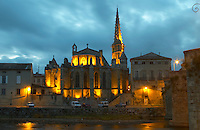 The gothic St Martin Church and the bridge across the l'Aude river. Town of Limoux. Limoux. Languedoc. Illuminated at evening time and night. France. Europe.