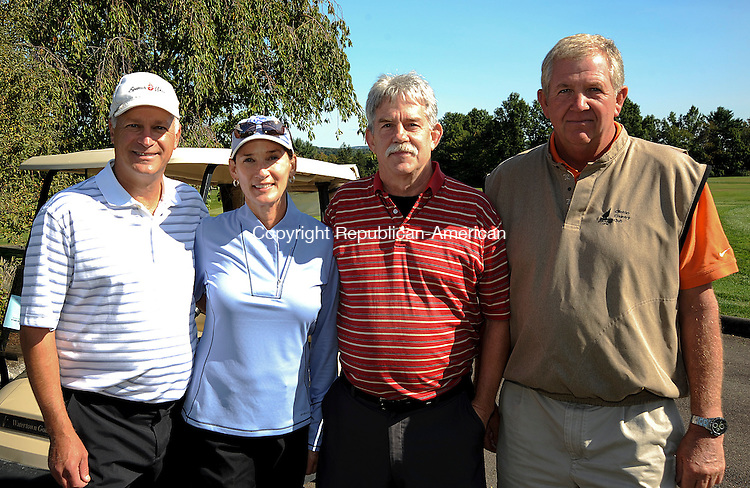 WATERTOWN, CT 17 SEPTEMBER 2013--091713JS13- Dave Segal and Leslie Segal of Woodbury; Ed Stukshis of Morris and Lynn Dayton of Watertown the annual Easter Seals Golf Classic at Watertown Gold Club in Watertown. All proceeds from the event benefit the programs and services for infants, children and adults with disabilities throughout Greater Waterbury, Central and Northwestern Connecticut. <br /> Jim Shannon Republican American