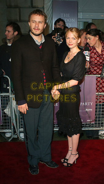 HEATH LEDGER & MICHELLE WILLIAMS.Pre-Bafta party, Spencer House, London, UK..February 18th, 2006 .Ref: BEL.full length black dress suit jacket blue couple holding hands.www.capitalpictures.com.sales@capitalpictures.com.© Capital Pictures.