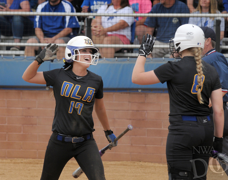 NWA Democrat-Gazette/BEN GOFF -- 05/15/15 Sydney Parr (17) celebrates with North Little Rock teammate Hannah Lovercheck after scoring in the sixth inning of the second-round game against Rogers in the 7A State Softball Championships at Veterans Park in Rogers on Friday May 15, 2015.
