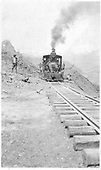 An RGS C-16 leads the first train past the Ames Slide after clearing of the blockage by a bulldozer.<br /> RGS  Ames, CO  6/1930
