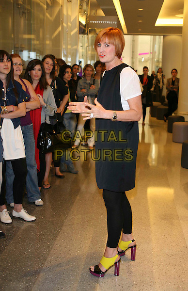 MARY PORTAS .Opening of Living & Giving shop in Westfield Shopping Centre, London, England, UK, June 4th 2009..full length white t-shirt black dress hands shoes sandals open toe yellow purple heels platforms .CAP/DS.©Dudley Smith/Capital Pictures