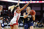 SIOUX FALLS, SD - MARCH 8: Katie Kirkhart #3 of Oral Roberts tries to drive around Madison McKeever #23 of the South Dakota Coyotes at the 2020 Summit League Basketball Championship in Sioux Falls, SD. (Photo by Richard Carlson/Inertia)