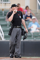 Home plate umpire Robert Waterhouse works a game between the Charleston RiverDogs and the Kannapolis Intimidators on Saturday, June 28, 2014, at CMC-Northeast Stadium in Kannapolis, North Carolina. Kannapolis won, 4-3. (Tom Priddy/Four Seam Images)