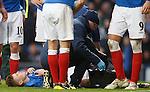 Lewis MacLeod clutching his knee